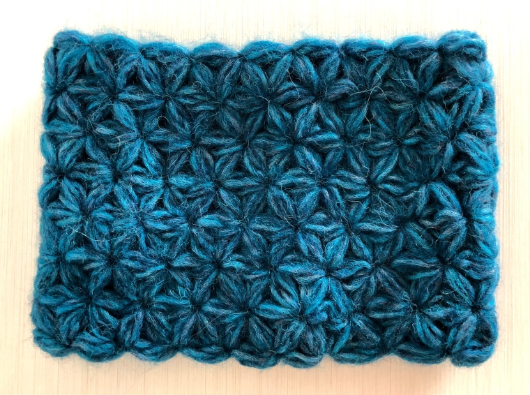 A blue crochet Jasmine Cowl made with jasmine stitches