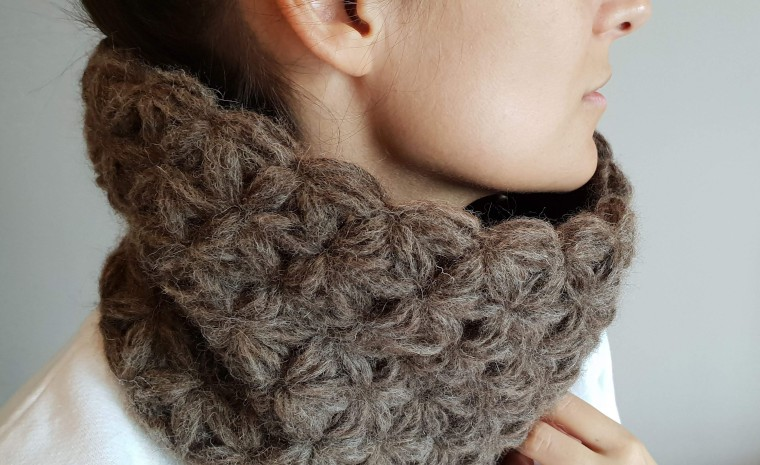 Model wearing the crochet jasmine cowl.