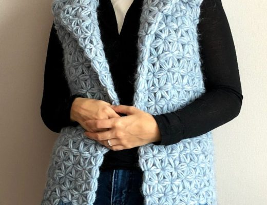 Model wearing the crochet jasmine vest made of jasmine stitch.