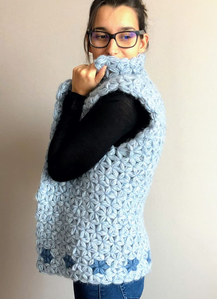 The Crochet Jasmine Vest seen from the side modeled by Susana from Fluffy Stitches