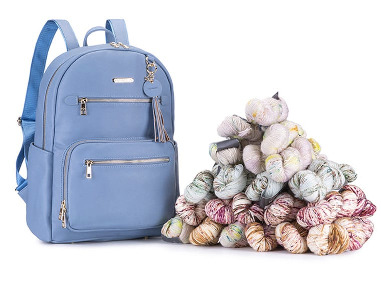 The Namaste Maker's Backpack in blue, one of the top gifts for crocheters & knitters