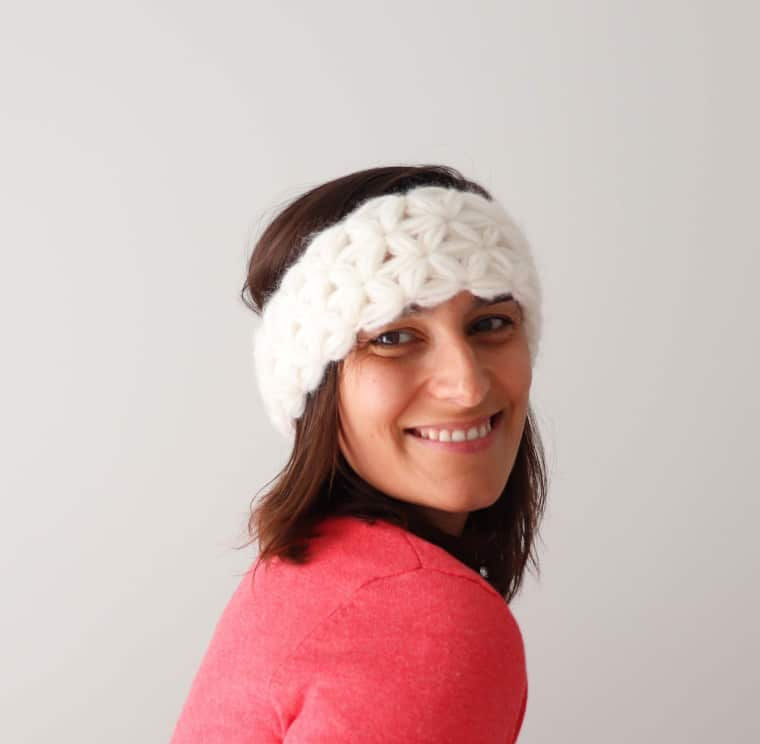 Susana from Fluffy Stitches wearing the Crochet Jasmine Headband with a pink jacket