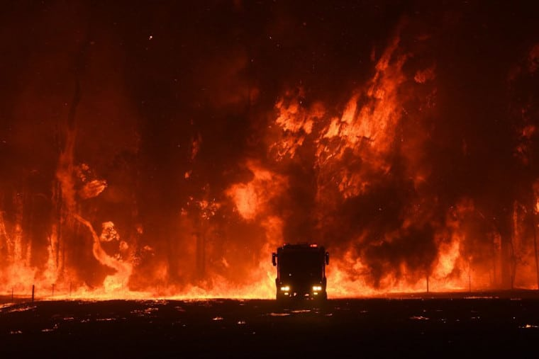 Firefighters overwhelmed by flames at bushfire in Orangeville.