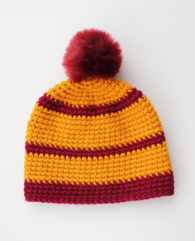 The crochet Cross Stitch Beanie against a white surface