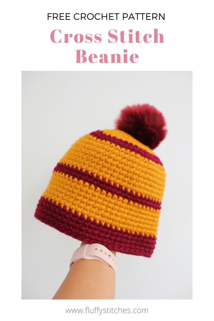 Get rid of scraps with the Crochet Cross Stitch Beanie! An easy project, just as if you were making single crochets and quick due to the bulky yarn. Grab your scraps and pom-poms lying around and give them a new life!