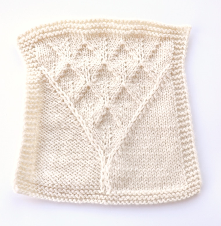 A knitted square that wasn't blocked