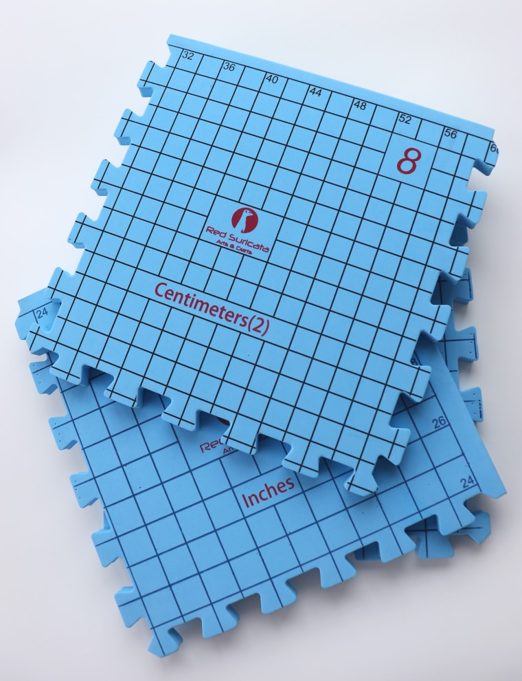 Blue blocking mats on a white surface