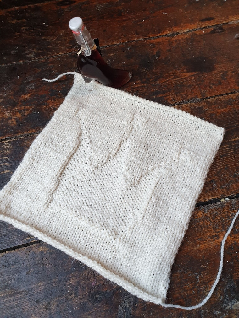 The third square of the Traveling Knit Afghan by The Queen Stitch