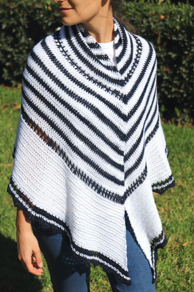 The Promenade Shawl on the shoulders of a woman