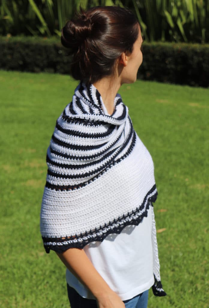 The Promenade Shawl wrapped around the shoulders of a woman