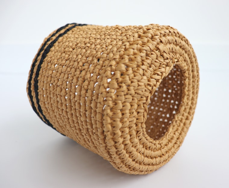The bottom of the raffia sleeve.