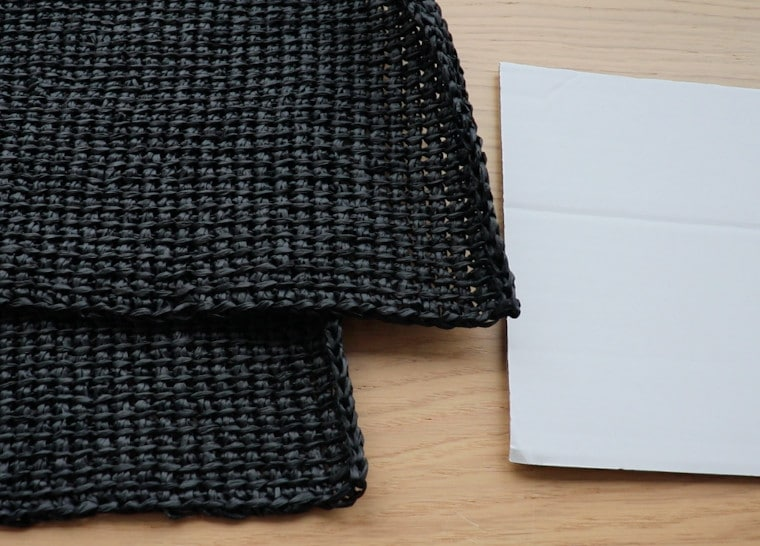 Two panels made in Tunisian Crochet with black raffia and a piece of cardboard