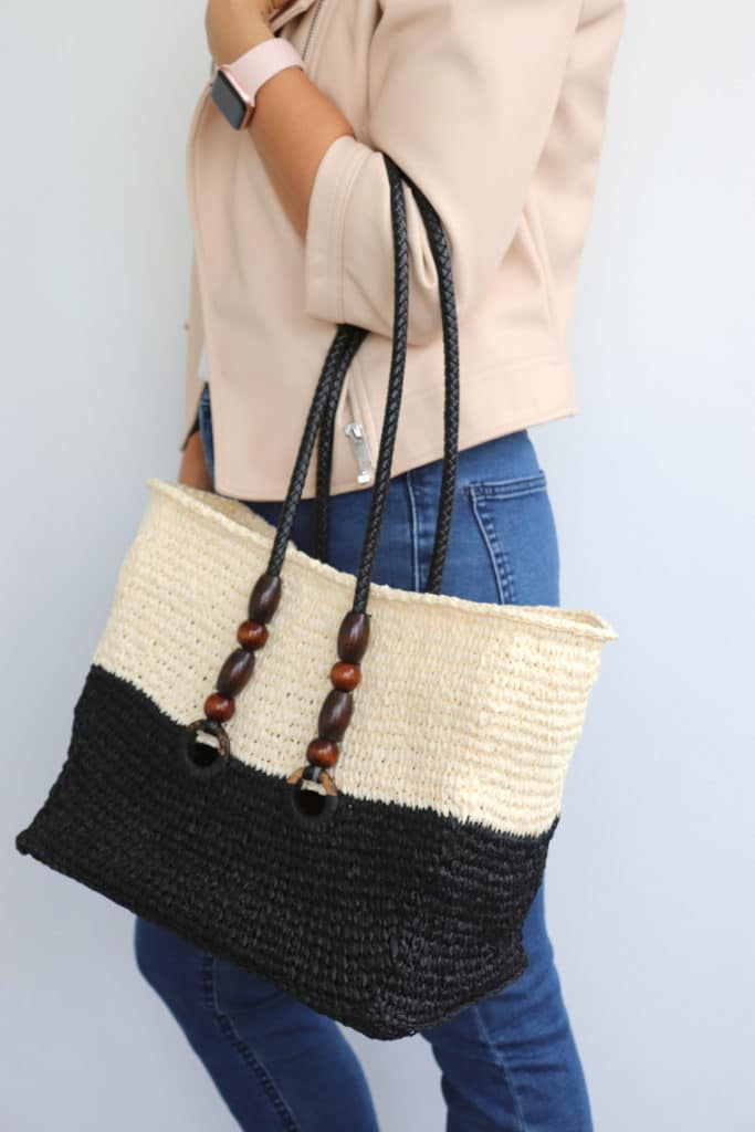 Model wearing the finished Tunisian raffia Bag Project in the arm