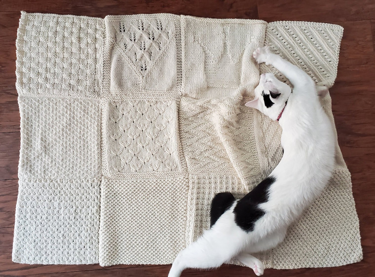 The twelfth square of the Traveling Knit Afghan by jellyKnitting