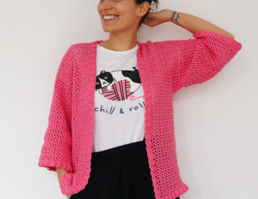 Woman wearing the Crochet Easy Ribbed Cardigan in Bubblegum Pink