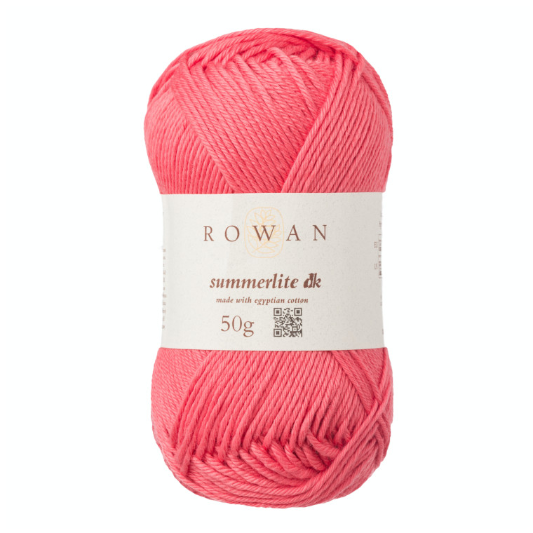 A skein of Rowan Summerlite DK in Coral Blush against a white surface