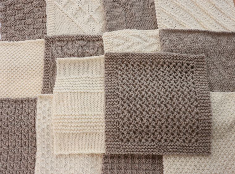 The fourteen squares of the Traveling Knit Afghan so far