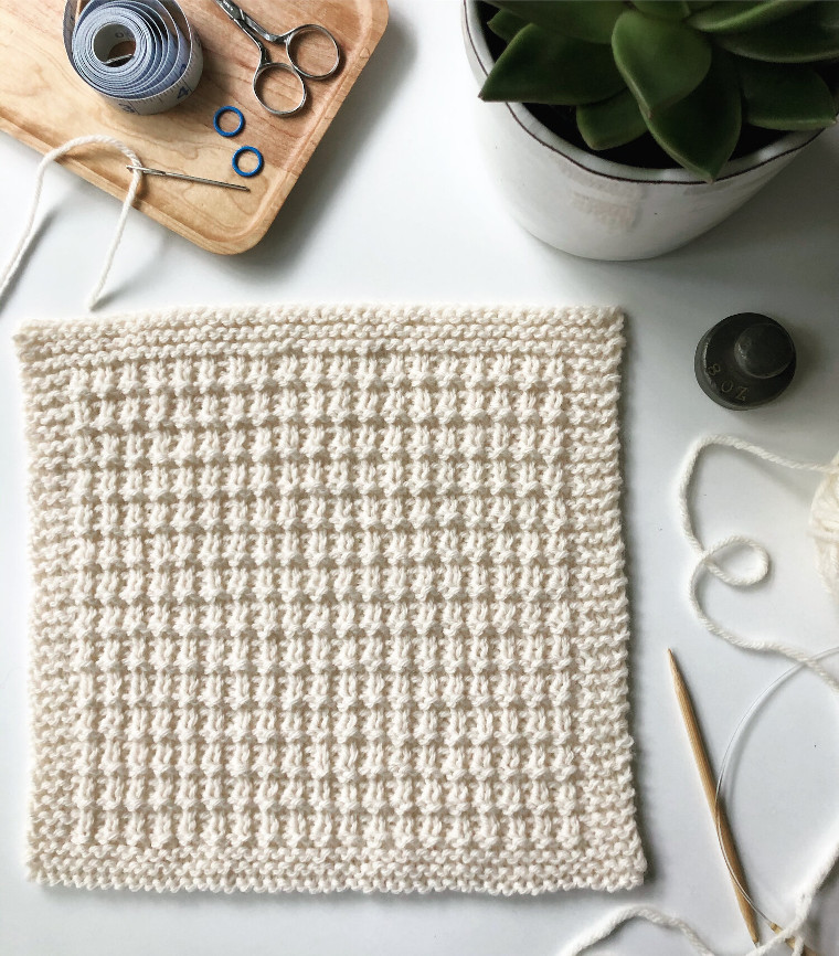 The sixteenth square of the Traveling Knit Afghan by Fifty Four Ten Studio