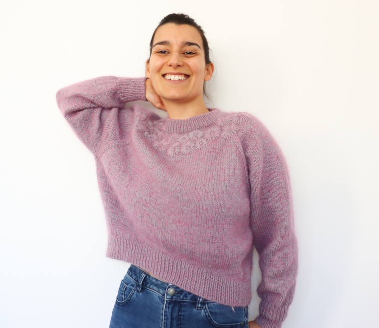 Woman laughing while wearing the Knit Grinalda Sweater by Rosa Pomar