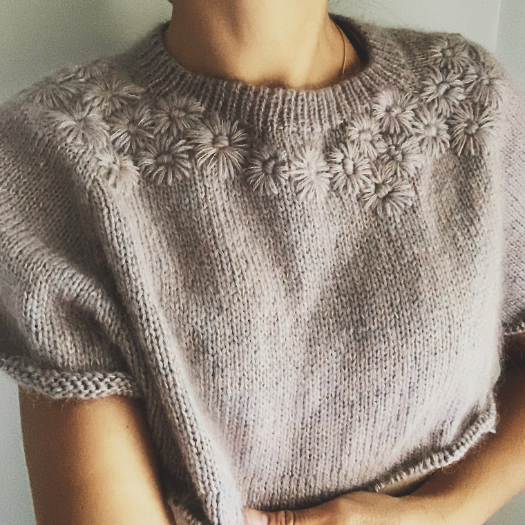 An Instagram progress picture of the yoke of the Grinalda Sweater with flowers already embroidered from Rosa Pomar.
